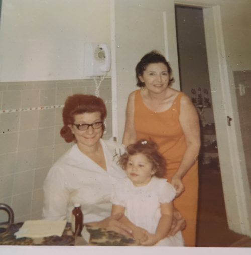 My maternal Grandmother Antoinette (red hair) and my paternal Grandmother Virginia (black hair).